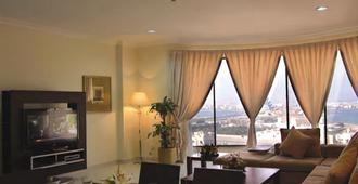 Sea Scene Hotel Apartments - מאנאמה - סלון