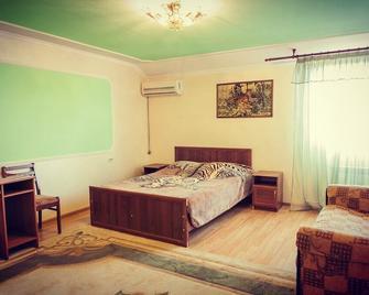 Hotel Vita - Stavropol - Slaapkamer