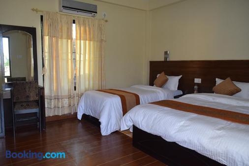 Chitwan Village Resort - Chitwan - Bedroom