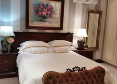 Royal Ridge Guest House and Apartments - Pretoria - Bedroom