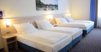 ECONTEL HOTEL München - מינכן - חדר שינה