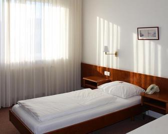 Hotel Post Rosbach - Rosbach vor der Höhe - Slaapkamer