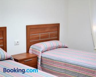 Apartamentos casa enrique - Cee - Bedroom