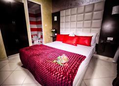 Hotel Vents Des Iles - As-Sawira - Sypialnia