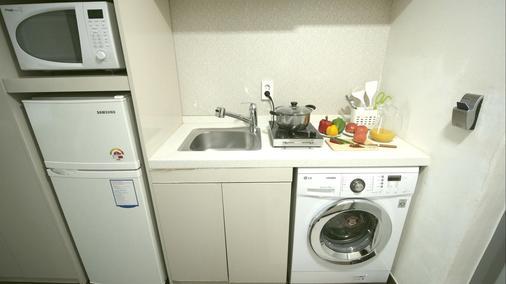 Residence Mumum Hotel - Busan - Laundry facility