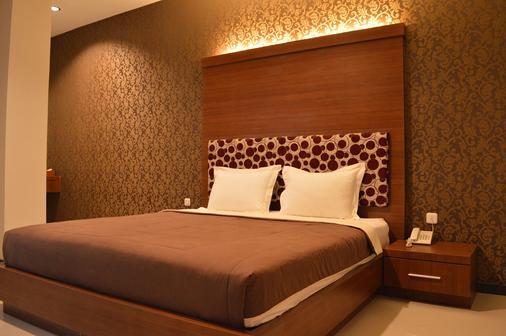 Grand Darussalam Syariah Hotel - Medan - Schlafzimmer