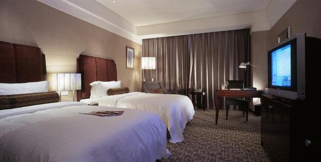 Ruiwan New Century Hotel Tianjin - Binhai - Bedroom
