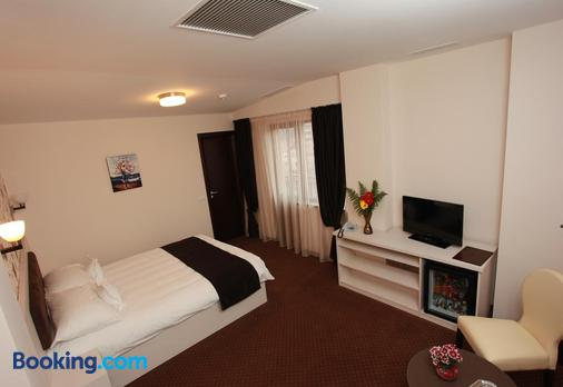 West Plaza Hotel - Bukarest - Schlafzimmer