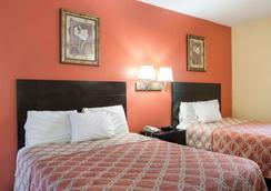 Rodeway Inn & Suites Humble - Humble - Bedroom