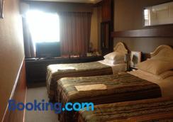 鹿兒島Gasthof飯店 - 鹿兒島 - 臥室