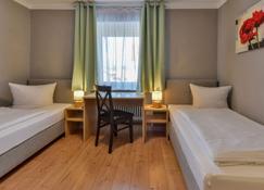 Hotel & Gasthof Krone - Augsburg - Bedroom