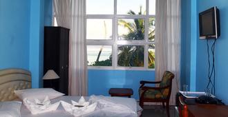 Visit Beach Inn - Malé - Habitación