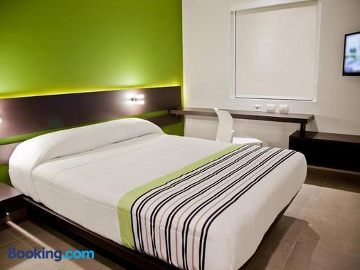 City Express Junior Puebla Finsa - Puebla City - Bedroom