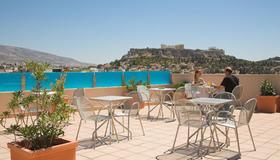 Arion Athens Hotel - Aten - Balkong