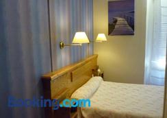 Hotel Restaurant Lons - Foix - Bedroom
