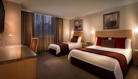 Best Western Plus Travel Inn Hotel - Melbourne - Bedroom