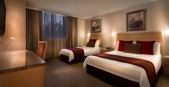 Best Western Plus Travel Inn Hotel - Melbourne - Schlafzimmer