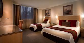 Best Western Plus Travel Inn Hotel - מלבורן - חדר שינה