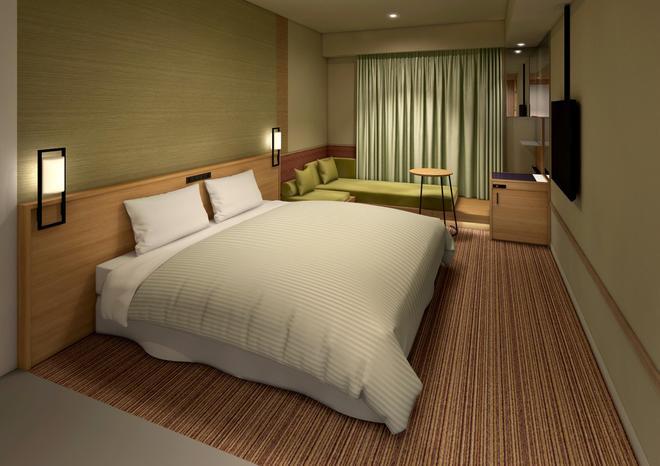 ザ シンギュラリ ホテル & スカイスパ アット ユニバーサル・スタジオ・ジャパン - 大阪市 - 寝室