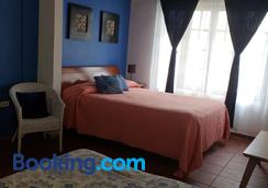 Andalucia Guest House - San Juan - Bedroom