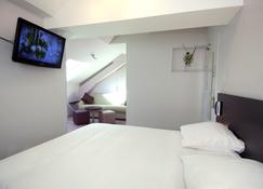 1924 Hôtel Grenoble - Грeнобль - Спальня