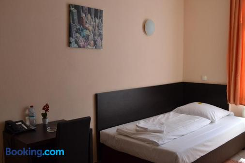 Angel Hotel - Frankfurt/ Main - Phòng ngủ