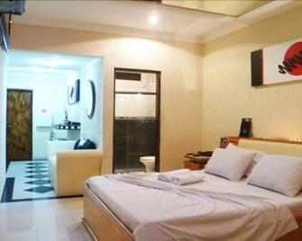 Dinys Motel - Adults Only - Praia Grande - Schlafzimmer