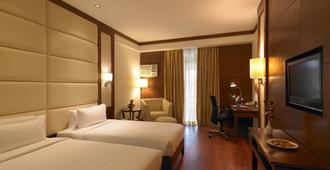 Royal Orchid Resort & Convention Centre - Bengaluru - Schlafzimmer
