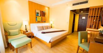 Pinnacle Lumpinee Park Hotel - Bangkok - Bedroom