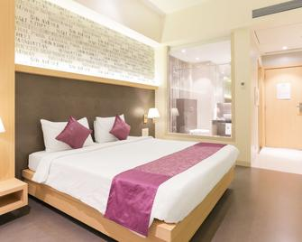 Treebo Select Gopalas Residency - Bhiwandi - Bedroom