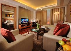 أجنحة فراسير سيف البحرين - المنامة - غرفة معيشة