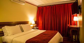 Hotel Pousada do Arcanjo - אורו פרטו - חדר שינה