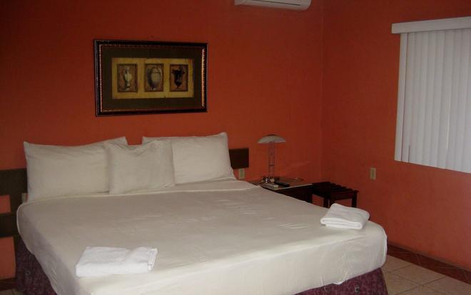 Hotel Real Altamira - Managua - Makuuhuone