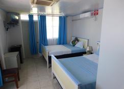Mr. Clean Bed & Breakfast - Roseau - Bedroom