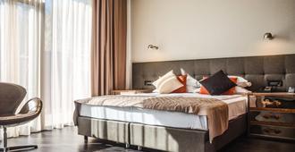 M1 club hotel - Odesa - Schlafzimmer
