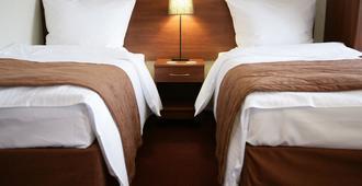 Aparthotel Globus - קראקוב - חדר שינה