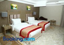 Sun and Sands Plaza Hotel - Dubai - Phòng ngủ