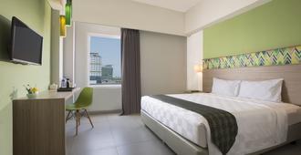 Pesonna Hotel Makassar - Makassar - Bedroom