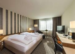 Maritim Hotel Stuttgart - Stuttgart - Yatak Odası