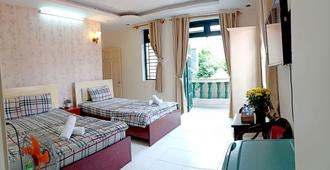 Lan Anh Hotel - הו צ'י מין סיטי - חדר שינה