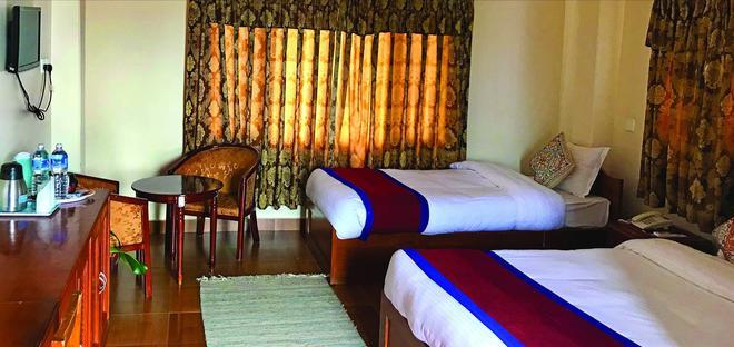 Hotel Asia - Pokhara - Phòng ngủ