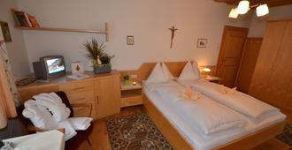 Gästehaus im Pfarrhof - באד הופגאשטיין - חדר שינה