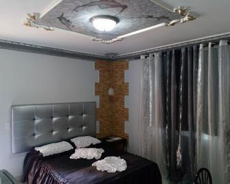 Xanadú B&b - Holguín - Schlafzimmer