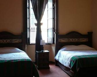 Hotel Casa Quetzaltenango - Кесальтенанго - Bedroom