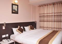 Lemon Tree Hotel - Kathmandu - Bedroom