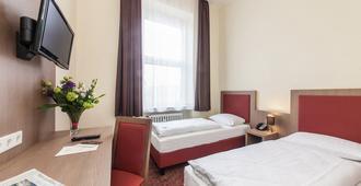 Novum Hotel Maxim Düsseldorf City - Düsseldorf - Slaapkamer