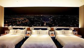Airline Inn Green Park Way - Đài Trung - Phòng ngủ