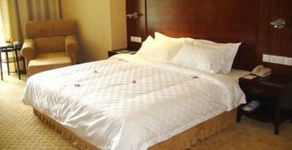 Enjoying International Hotel - Kunming - Habitación