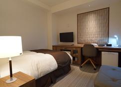 Ofunato Plaza Hotel - Ōfunato - Bedroom