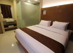 Os Hotel Airport Batam - Batam - Κρεβατοκάμαρα